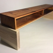"""Coffee table base is ash and left """"clean"""" and unfinished to contrast the fir."""