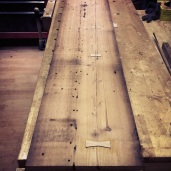 Salvaged 100 year old douglas fir features nail holes and other character marks.