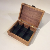 Walnut veneer on inside of top. Dividers make the box perfect for tea, jewelry or keepsakes.