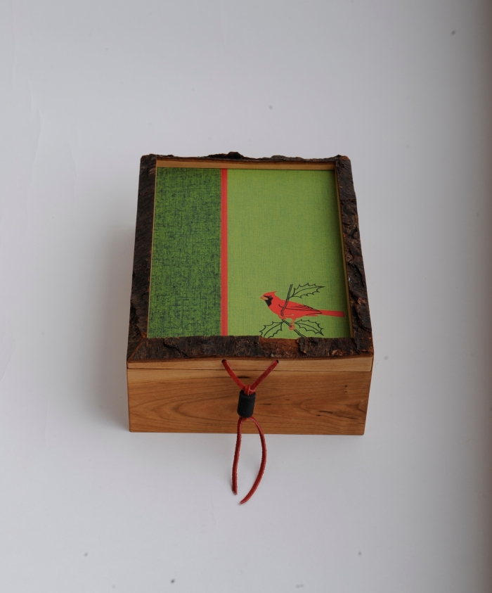 Live-edge cherry box with recycled book cover as top and bottom panel. $80.00