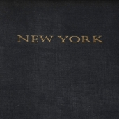 """""""NEW YORK"""" in gold type. Underside of cover features b&w photo of NY at night."""