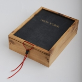 """White oak box with recycled """"New York"""" book covers for the top and bottom panel."""
