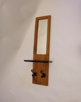 Cherry mirror with live-edge shelf and iron hooks.