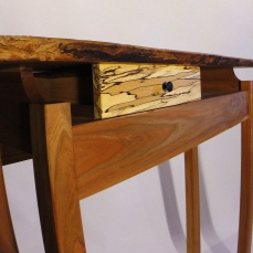 Dramatic natural lines seen in both the spalted maple drawer front and live-edge top.